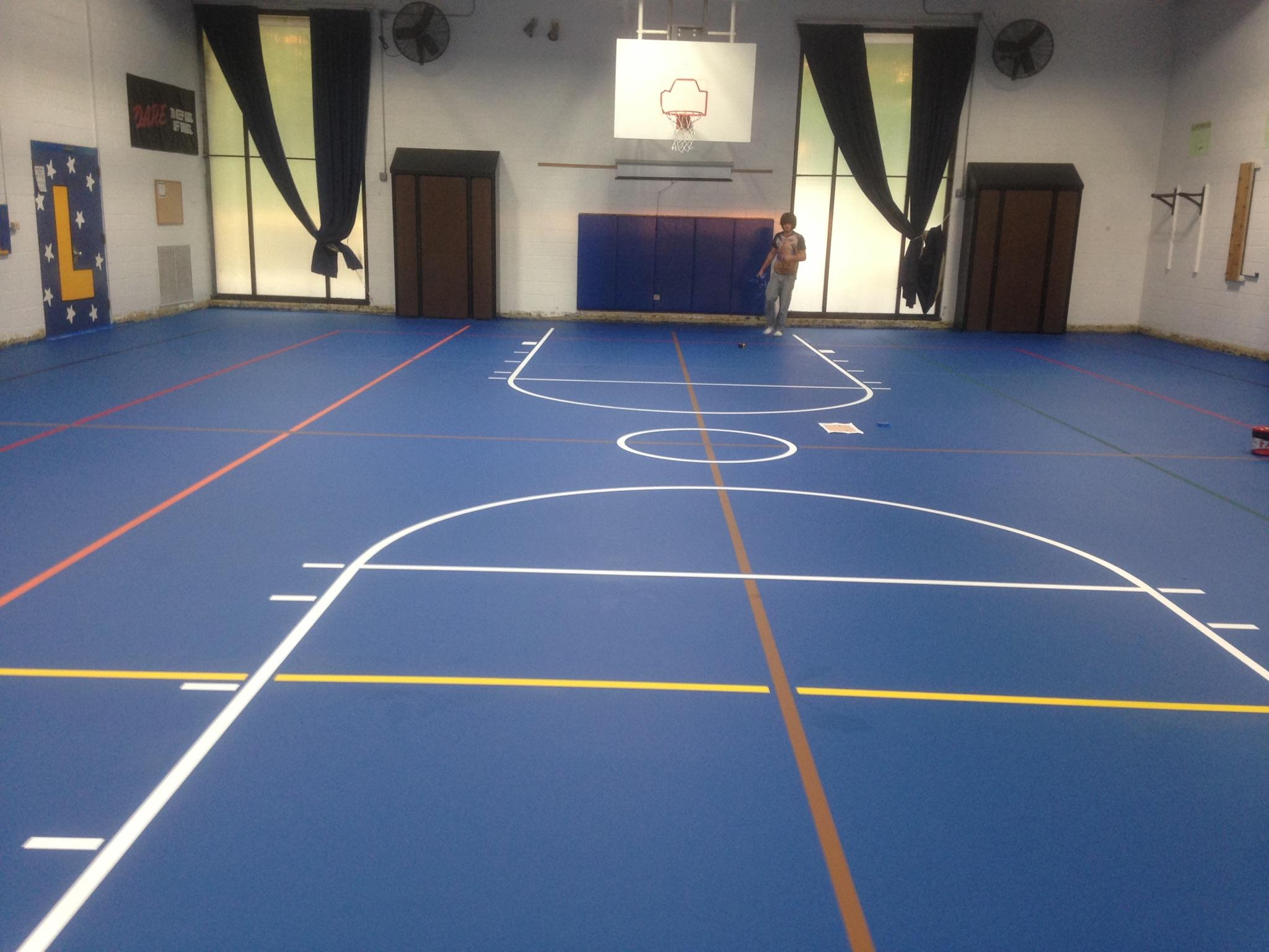 multipurpose sport floor installation with action herculan